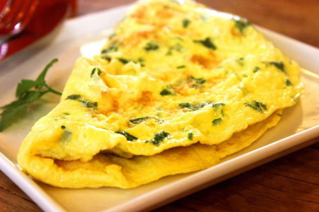 egg and chive omelet on white square dish