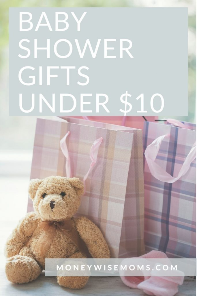 Baby shower gifts under $10 with teddy bear and pastel gift bags on table