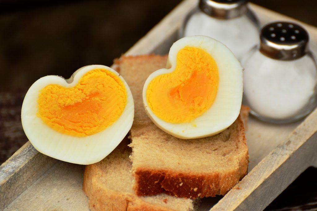 Heart shaped hard boiled eggs on bread