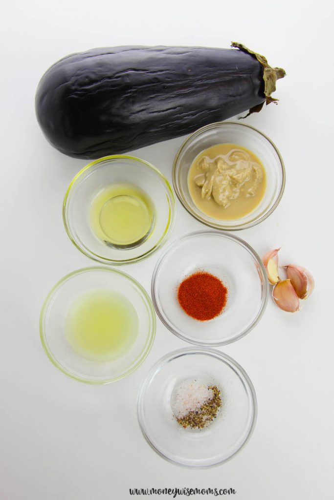 Ingredients needed to make roasted eggplant dip baba ganoush laid out before we begin cooking.