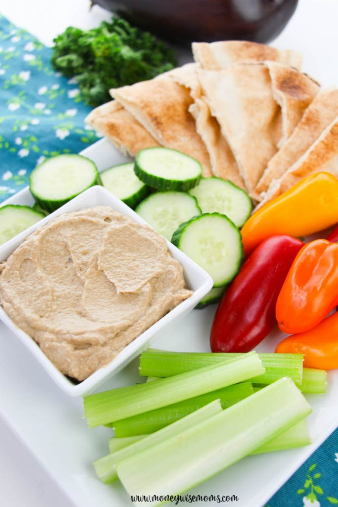 The finished recipe for roasted eggplant dip ready to serve with pitas, veggies, and more.