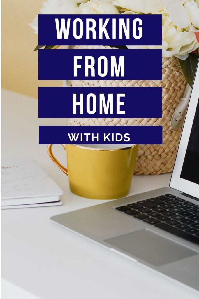 laptop and mug on desk with flowers in basket - working from home with kids
