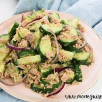 featured image for cucumber tuna avocado salad piled up on a plate.