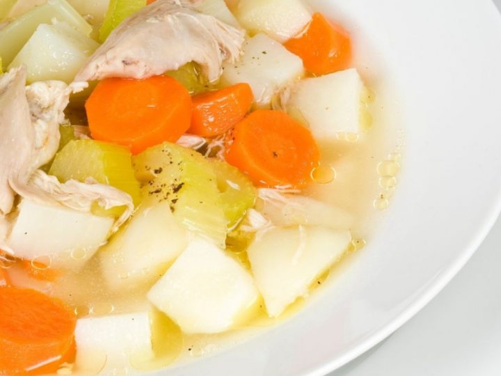White bowl of chicken potato soup