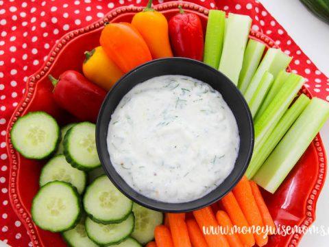 featured image with veggies around the bowl of tzatziki recipe ready to eat.