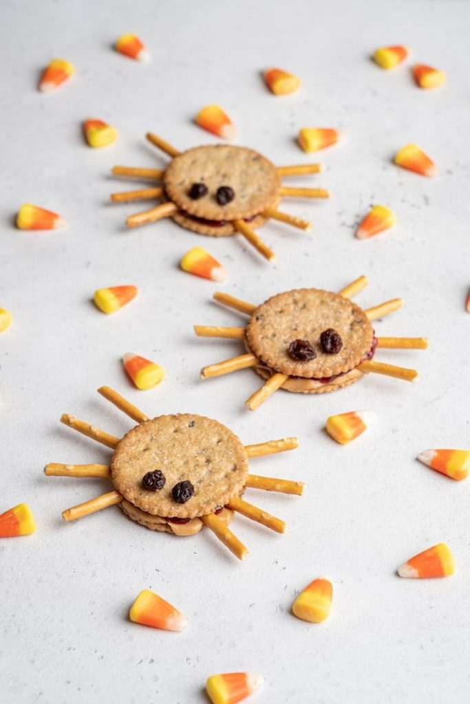 Cute Halloween snack - cracker and pretzel spiders with candy corn
