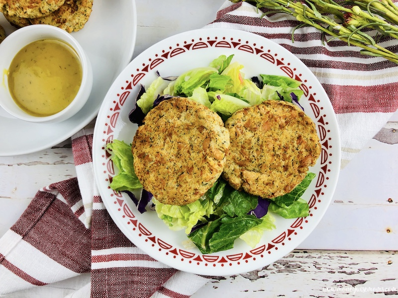 top down view of the finished easy recipe for salmon patties on a bed of greens ready to eat.