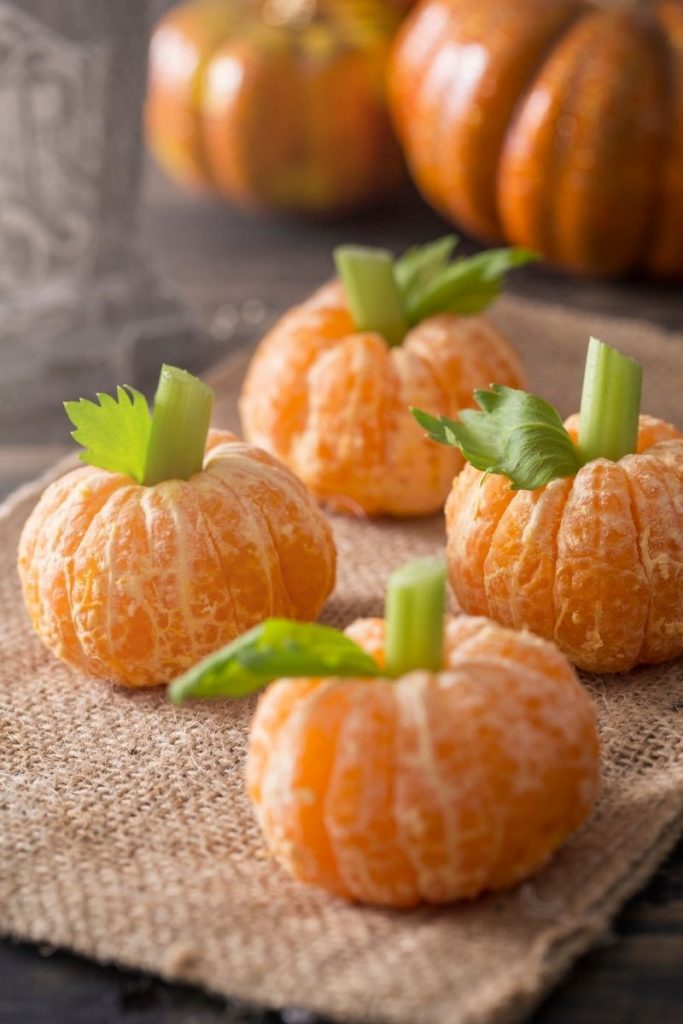 Mandarin oranges turned into pumpkins with celery stems - Halloween movies animated for kids