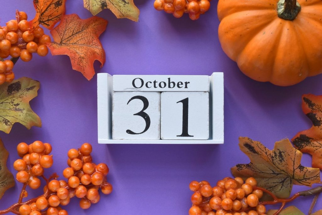 October 31 on purple background with orange leaves