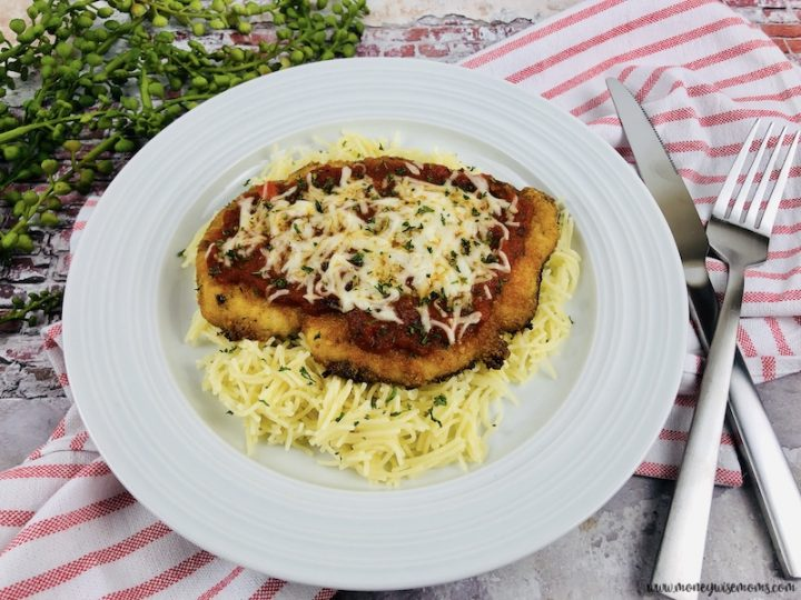 Featured image showing the finished chicken parmesan baked in the oven ready to eat.