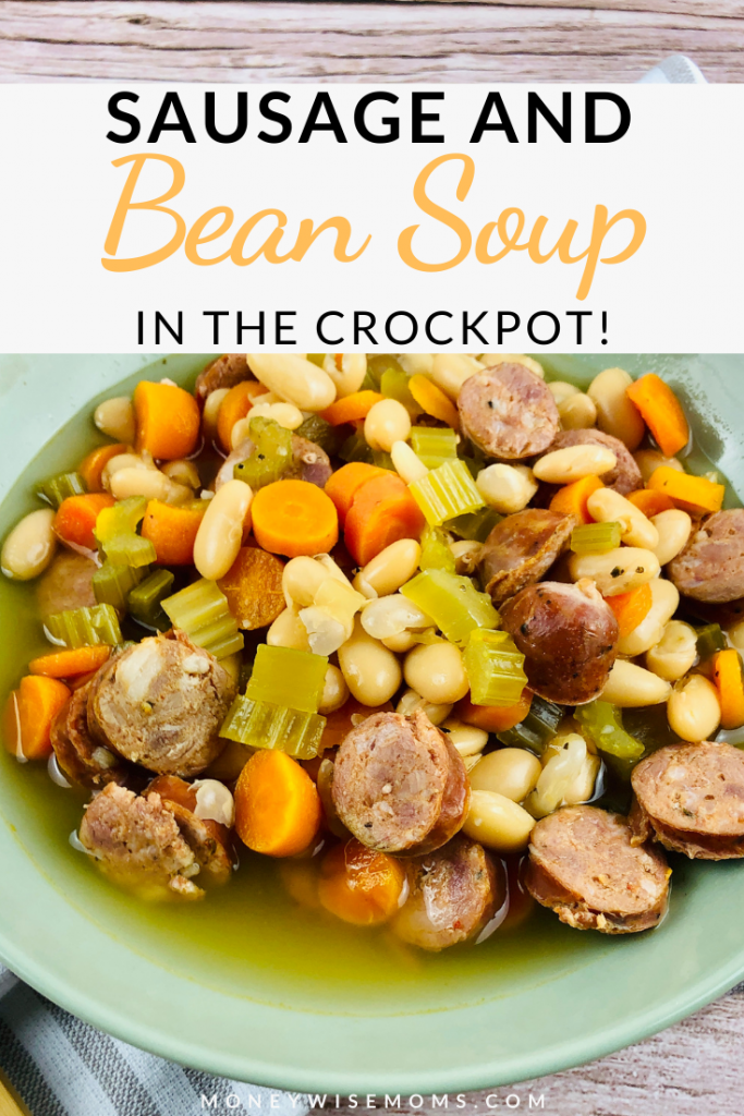 Pin showing the finished sausage and bean slow cooker soup ready to eat.