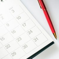 Black and white calendar with red pen