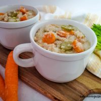 Featured image showing the finished slow cooker turkey soup with rice ready to eat